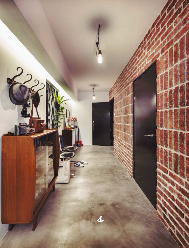 Modern vintage - street look brick wall with cement floor and woody furniture