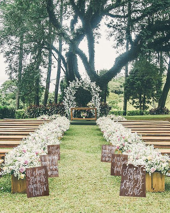 Our rustic wooden aisle signs make a beautiful statement for your ceremony. Each one is hand made and hand painted. After your special day, you can even hang them in your home or give them as gifts! This design is from the 1 Corinthians 13 verses, but you can request a custom design or verse. Dimensions: This set includes 6 signs that each measure 15x11 inches. Each one comes with a collapsable stand on the back for a self standing display. If you need more or less than 6, just let us know…