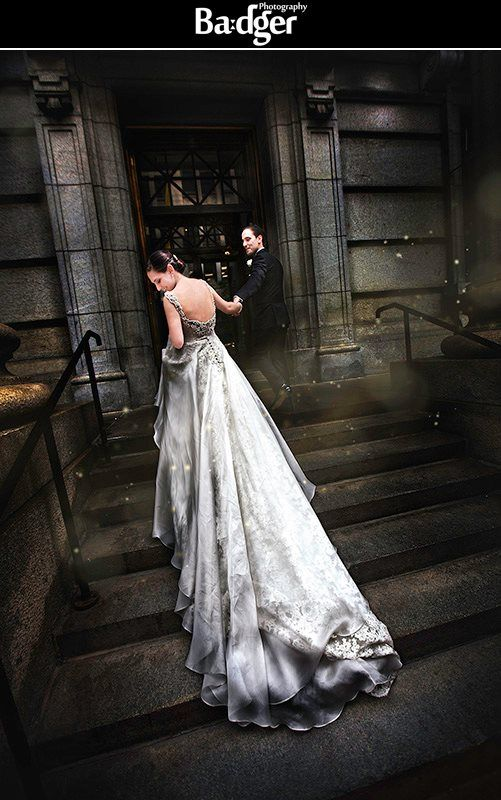 We love incorporating Montreal's beautiful architecture in wedding photos! Portrait of bride and groom in front of the Saint-James Theater at an Italian wedding in Montreal -- by Badger Photography