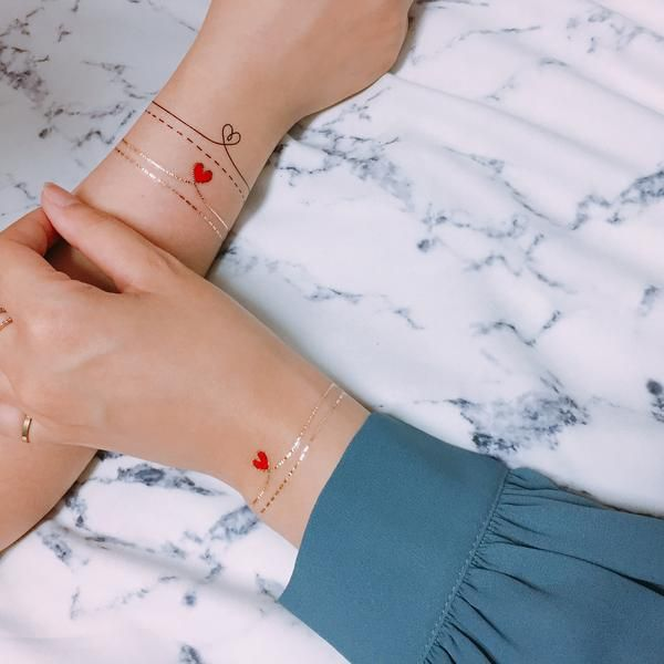 All You Need Is Love Temporary Tattoo | Red heart tattoos, Heart temporary tattoos, Wrist tattoos for women