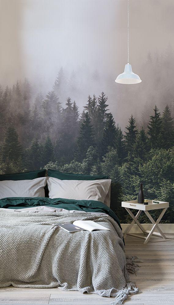"""Wenn Sie ein ultimatives Gefühl von Ruhe und Gelassenheit in egal welchem Zimmer Ihres Hauses erzeugen möchten, ist unsere """"In den Waldgebieten""""-Fototapete der perfekte Weg innerhalb Ihres Zuhause in die Natur zu entfliehen. Diese wunderschöne Fototapete zeigt einen dichten grünen Wald, der in eine Nebelwand gehüllt ist und für Ihr Schlafzimmer perfekt wäre."""