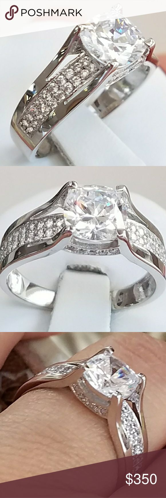 14k Solid White Gold Engagement Ring 14k Real Solid White Gold Engagement Ring with 1ct simulated man made Diamond Center stone. Total Karat is 1.5ct Available in sizes 5 6 7 8 9 Jewelry Rings
