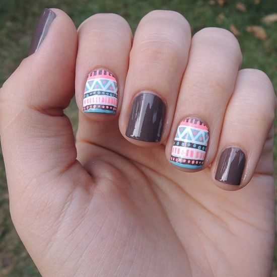 Tribal Nail art using brown pink white and blue