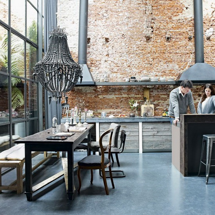 Factory Conversion in Amsterdam situated in the Jordaan area of Amsterdam Brickwork and concrete floors are carried through from the main part of the house while pendant lights provide a lovely warmth and ambience.