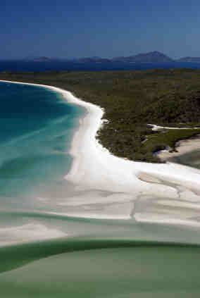 Whitehaven Beach  Difficult to get to and very quiet.  Can take helicopter to get there quicker.