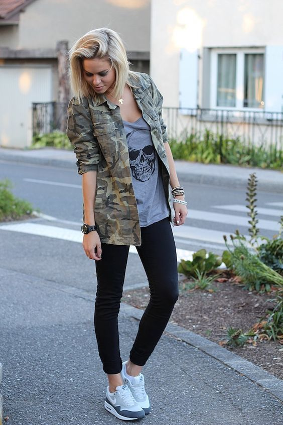 Wear an army green camouflage military jacket and black skinny jeans for a standout ensemble. Dress down your look with grey sneakers.   Shop this look on Lookastic: https://lookastic.com/women/looks/military-jacket-crew-neck-t-shirt-skinny-jeans/18278   — Olive Camouflage Military Jacket  — Grey Print Crew-neck T-shirt  — Black Skinny Jeans  — Grey Athletic Shoes  — Black Ceramic Watch