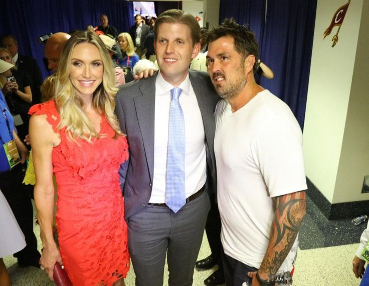 Eric Trump and his wife, Lara Yunaska, pose with Marcus Luttrell backstage after the state of New York puts Donald J. Trump over the top as the GOP presidential nominee at the Republican National Convention in Cleveland, Ohio, on Tuesday, July 19, 2016.
