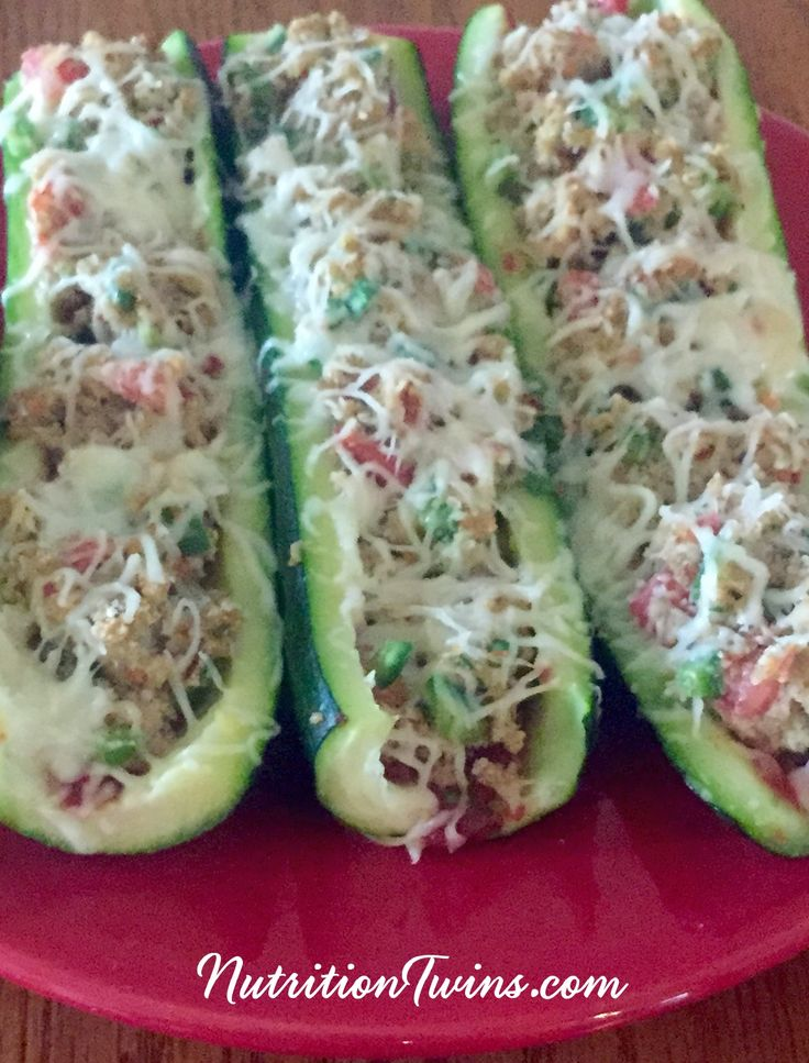 Baked Zucchini Boats | Only 114 Calories | Delicious way to get veggies & protein | Great satisfying appetizer to eat less at the meal | For MORE RECIPES please SIGN UP for our FREE NEWSLETTER NutritionTwins.com