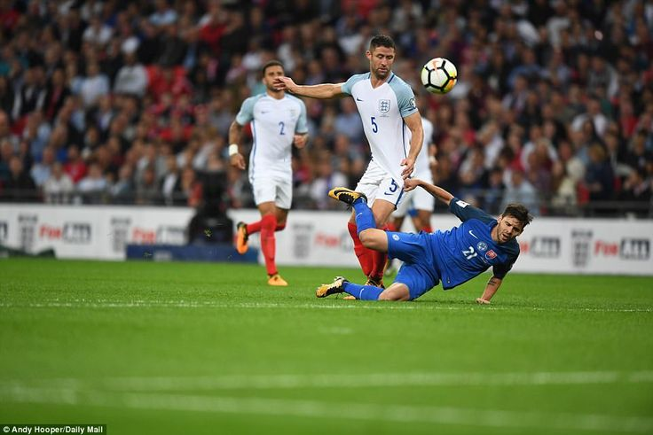 England centre back Gary Cahill tussles with Slovakia substitute Michal Duris at Wembley as the home side held on for the win
