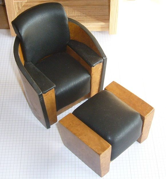 Art Deco or modern chair with foot rest. Ashwood veneer and black leather