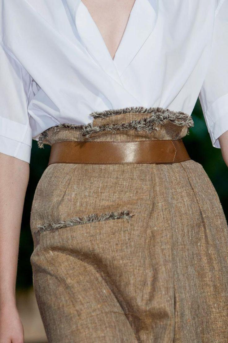 Frayed skirt edges- belted waist.