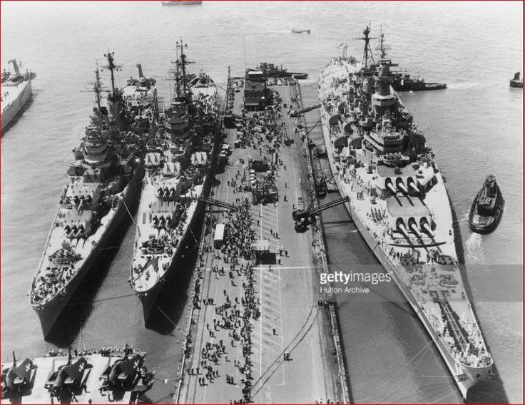 16th December 1952, The giant US, battleship USS 'Missouri' alongside the heavy ... and 'Macon' at Norfolk, Virginia