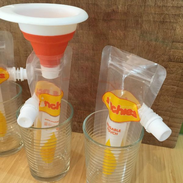 Sinchies Reusable Pouch Review - Mumma Plus Three - Top tip for filling your 80ml Sinchies pouches - stand them up in glasses and use a Sinchies collapsible funnel - Easy peasy