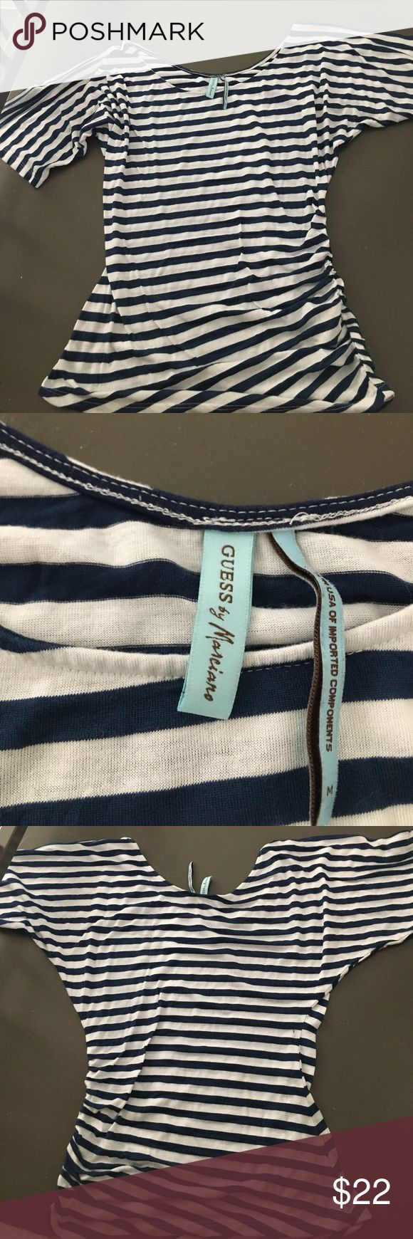 Guess Marciano Striped Tee Guess Marciano Striped Tee. Blue and white. Loose fit on top and snug fit in waist area. Perfect for spring! This is Size M but I am a S and it fits nicely as well. Guess by Marciano Tops Tees - Short Sleeve