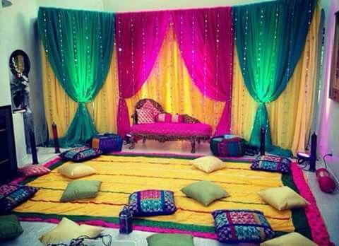 Colourful homely setup for the mehendi ceremoney | wedding decor | wedfine.com | wedding guide | wedding venue search portal | wedding blog |