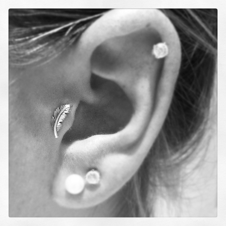 Ah! I always neglect my tragus piercing... But having this feather earring for it would change that!