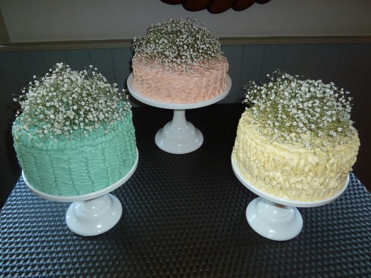 Instead of a three tiered cake, why not three cakes?  A very sweet idea for a luscious vintage wedding co-ordinated recently.