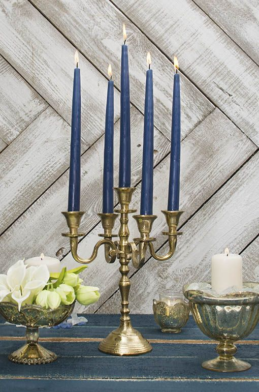 Pair these navy tapers with our gold candelabra and