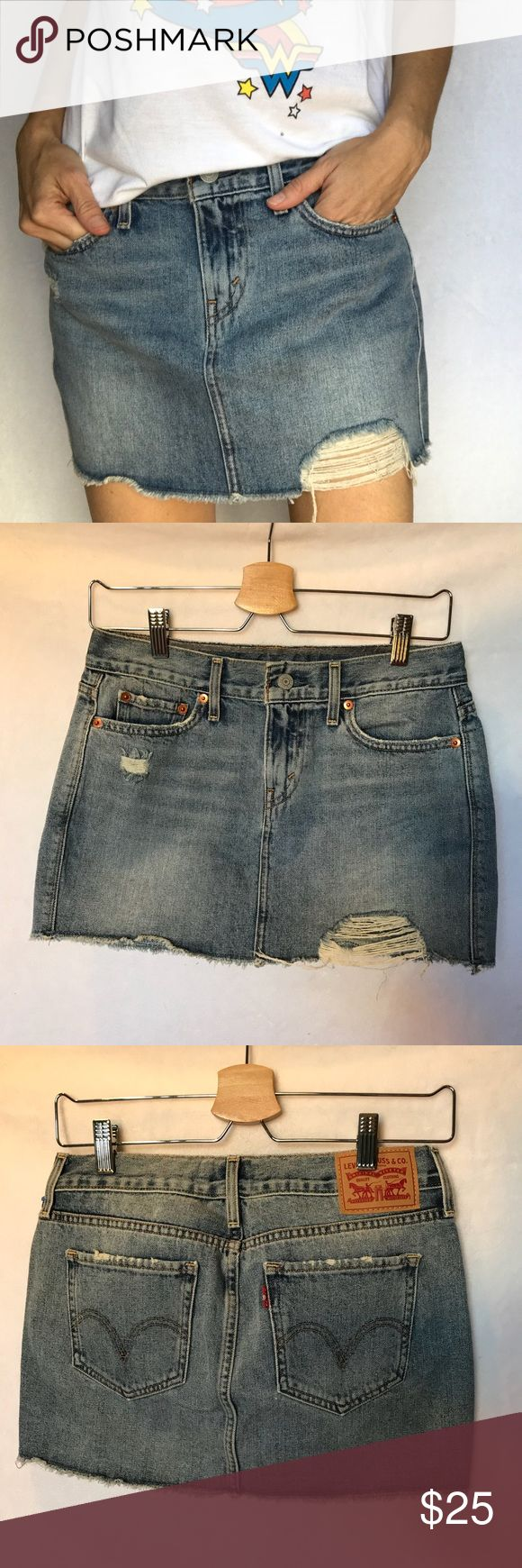 Levi's Jeans Skirt Women's size 25 Distressed Perfect condition Levi Skirt.  Size 25 Measurements in the pictures was taken flat.  No stains. Levi's Skirts Mini