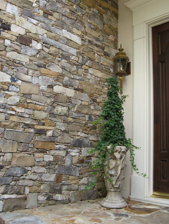 A Drystack Stone Entryway And Porch Welcomes Guests To