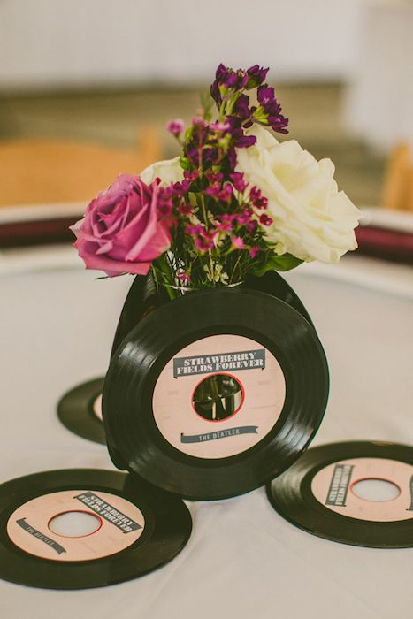 Vinyl centrepiece. 10 Music Inspired Wedding Ideas on @intimatewedding Photo by Carolyn Scott. #musicwedding #centrepiece #weddingtable