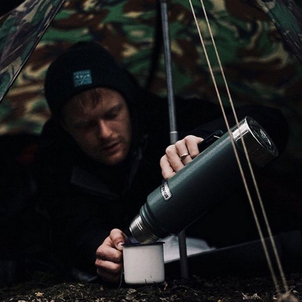 A hot cup of coffee goes a long way when you're looking for the perfect camp spot in the woods.