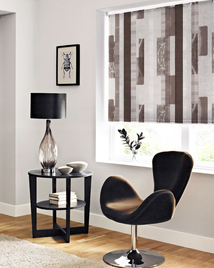Contemporary brown room with leather chair and stripe blinds