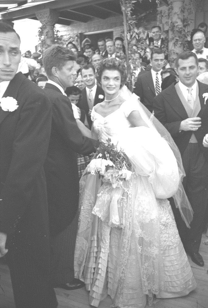 http://en.wikipedia.org/wiki/Jacqueline_Kennedy_Onassis American future First Lady Jacqueline Kennedy (1929 - 1994) poses with her husband politician and future US President John F. Kennedy (1917 - 1963) immediately after their wedding at Hammerstein Farm Newport, Rhode Island, September 12, 1953. (Photo by Lisa Larsen/Time & Life Pictures/Getty Images). http://en.wikipedia.org/wiki/Wedding_dress_of_Jacqueline_Bouvier