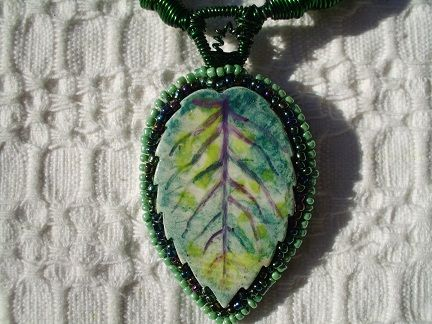 ceramic leaf with seed beads border