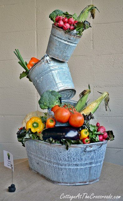 topsy turvy planter used as a centerpiece for a party, or even a kitchen centerpiece with artificial fruit and vegetables.
