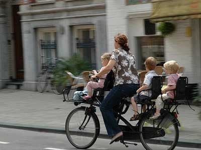 summer commute. Great photos of cycling with kids in Amsterdam.