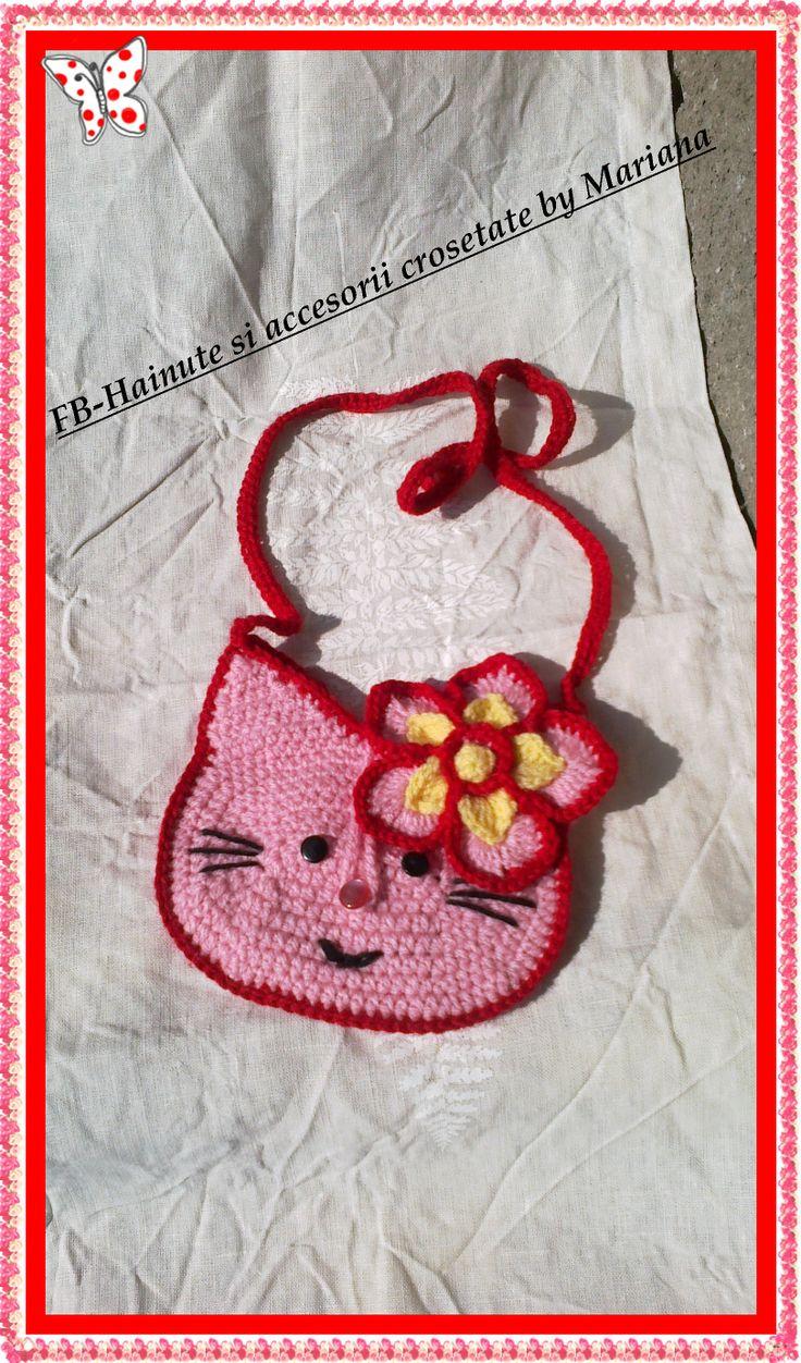 Posetuta Hello Kitty,un accesoriu ideal pentru fetite.