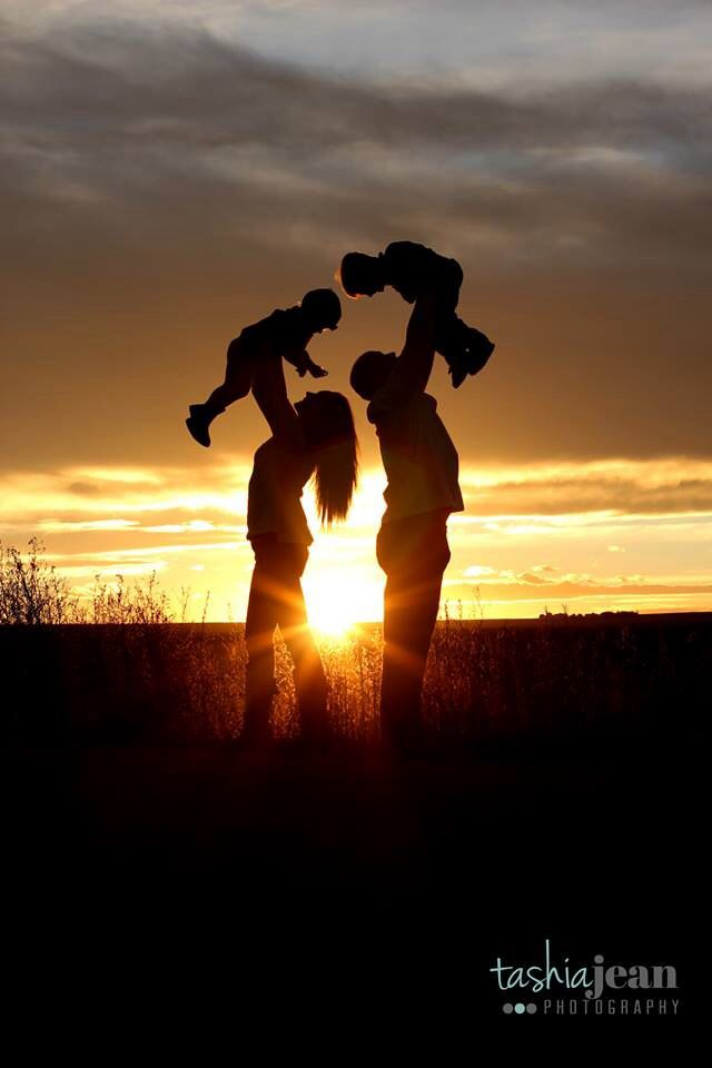 Cute family picture! Love the sunset background