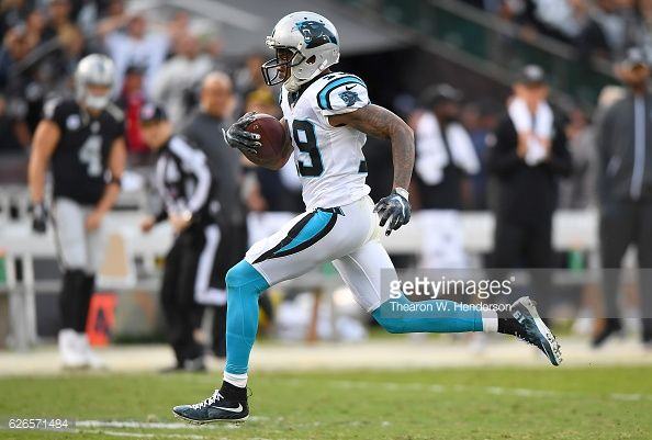 News Photo : Ted Ginn of the Carolina Panthers scores on an 88...