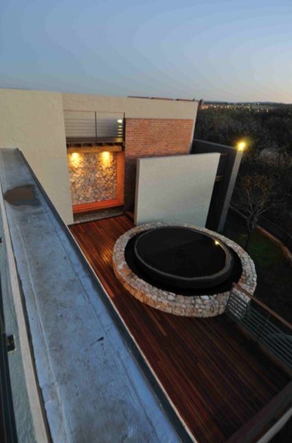 House Basson, in Pretoria, South Africa.This home is nestled on a hill in a Nature Reserve. The sloping site has a dual character, opening up to the views in the north while becoming more intimate and personal as you move southwards towards the nature reserve's green belt.Therefore the house has been positioned as high as possible and bordering on the green belt to make maximum use of the site's views and natural location. Completed, 2012,Mathews and Associates Architects.Photo by Wenzel…