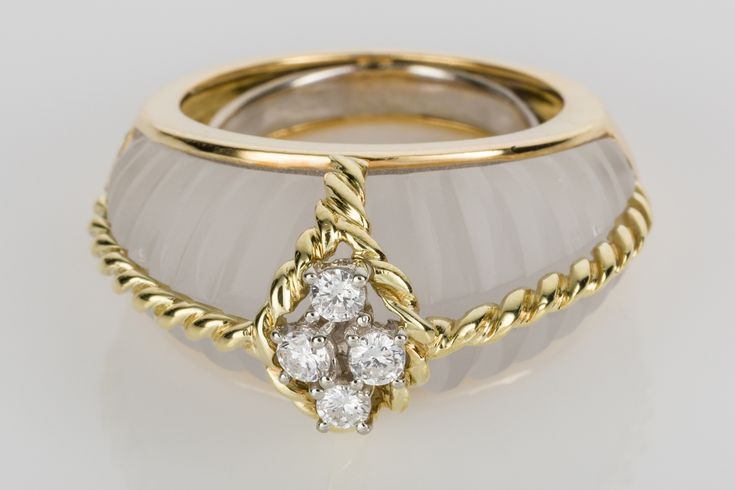 Fred Paris, a fabulously chic design with carved rock crystal, white diamonds and twisted 18k wire work. Looks amazing on! This cocktail ring screams Style!