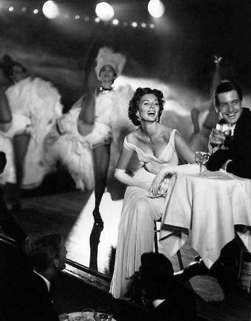 Suzy Parker (dress by Madame Gres) and Robin Tattersall at the Moulin Rouge, Paris, 1957. Photo: Richard Avedon.