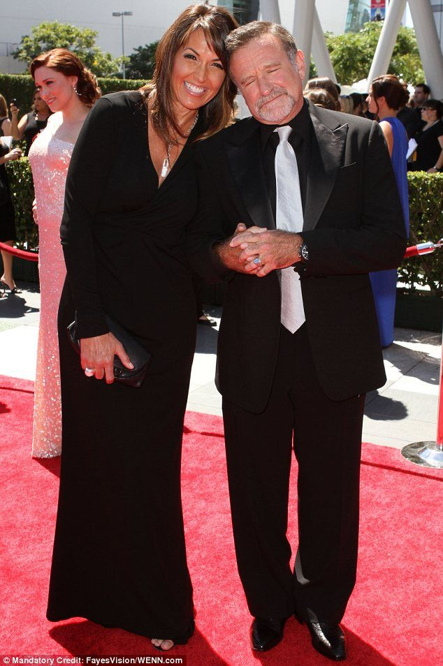 Rest in peace: Robin,e, leaves behind wife Susan Schneider. They are pictured in August 2...