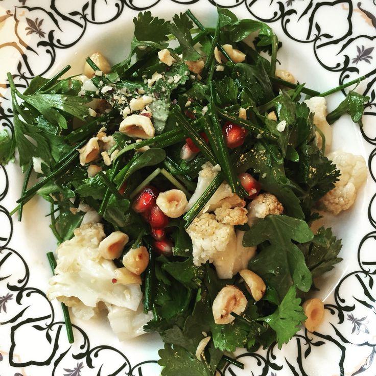 A crisp healthy roasted cauliflower, hazelnut, pomegranate and herb salad.
