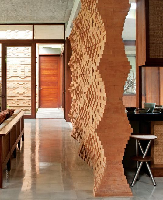 3 dimensional brick wall -hello. Who is the designer?