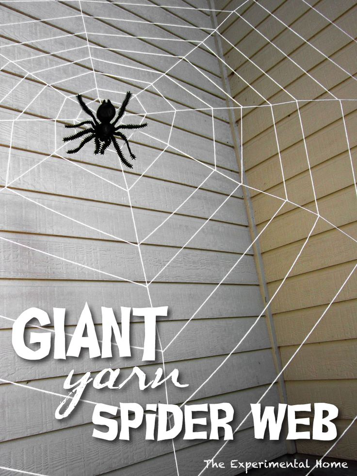 giant spider web made of yarn on a front porch complete with spider diy home decor. Black Bedroom Furniture Sets. Home Design Ideas