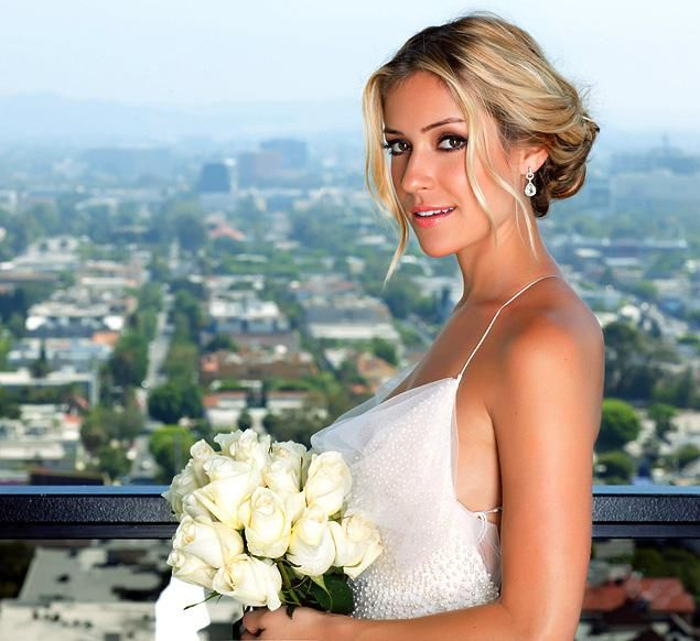 Kristen Cavallari announces her secret wedding over the weekend to Jay Cutler over twitter today. Pictured is Kristen posing in wedding dresses for Los Angeles bridal photographer Jonathan Clay Harris.
