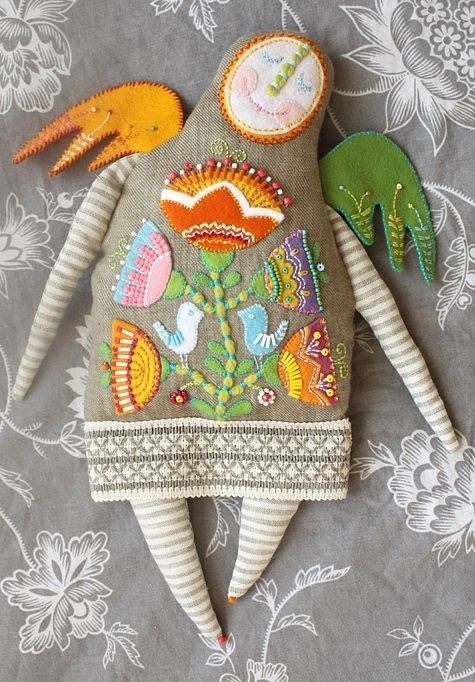 Love the embroidery on this doll