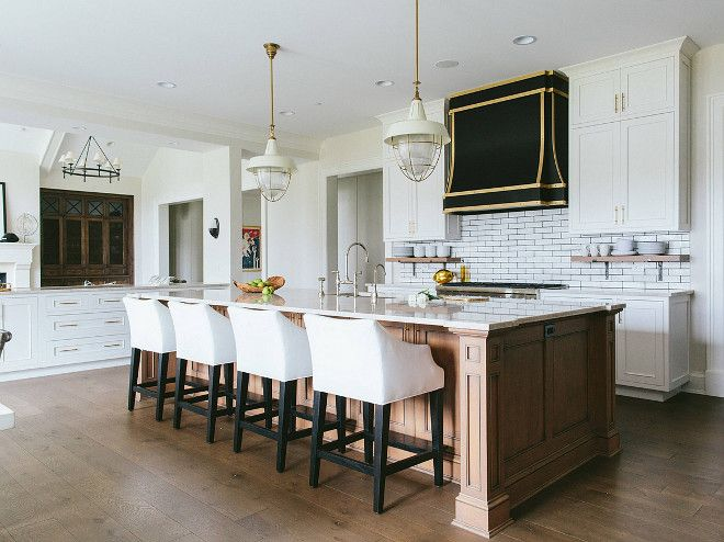 White Kitchen Cabinet With Wood Stained Island. The White