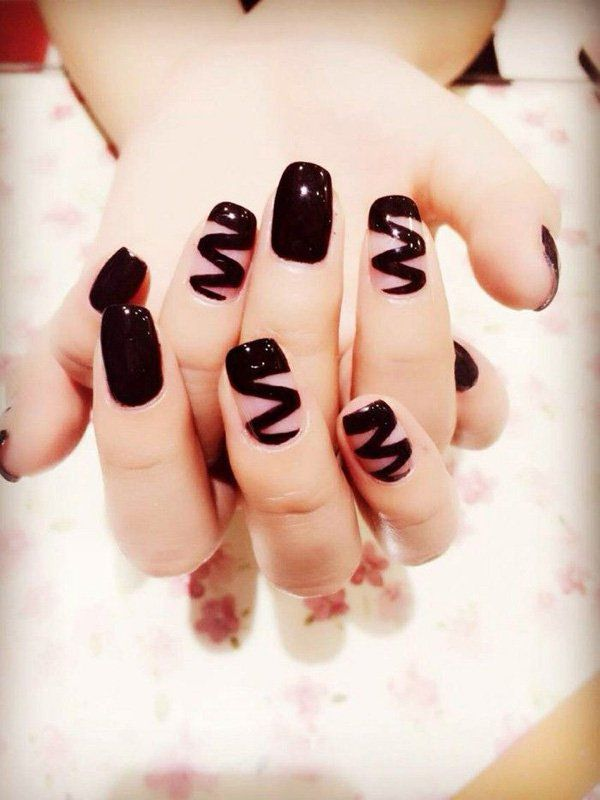 Black chocolate syrup inspired nail art design. Let your nails look like you've just dipped them into delicious chocolate with help from a rich filling of nail polish.