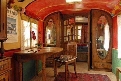 gypsy wagon.  (School bus?  Ceiling looks like one.)