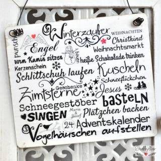 shabbyflair Holzschild mit winterlicher Textcollage mit dem Titel WINTERZAUBER