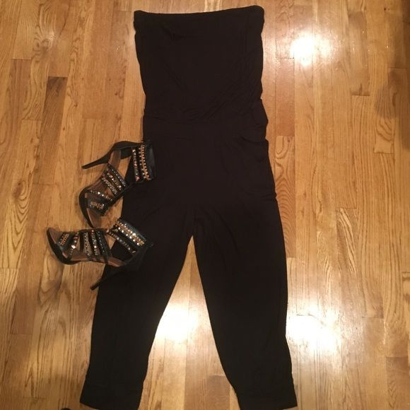 Black strapless jumpsuit Dress it up with a blazer and some heels! This has tons of stretch. Elastic waist New York & Company Pants Jumpsuits & Rompers
