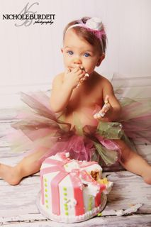 1-year-old bday pic! tutu, shirtless, headband, cake...maybe a balloon in background
