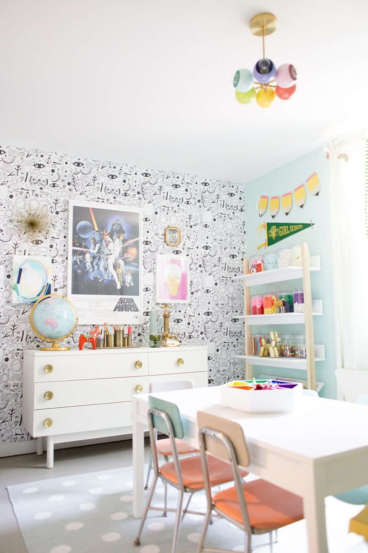 Cutest kids craftroom playroom ever. Love that crazy wallpaper and the bright rainbow colors!